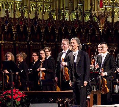 Maestro Kent Nagano with the orchestra