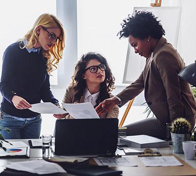 Three businesswomen discussing a report