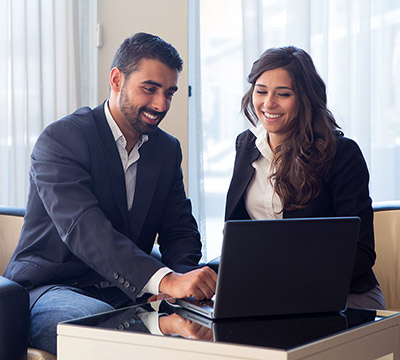 Two colleagues working in front of a laptop