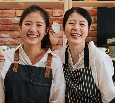 Two shopkeepers of Asian descent